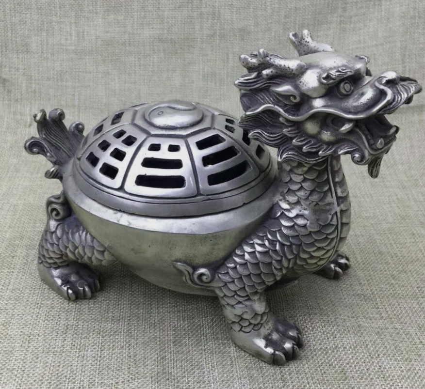 Черепаха с головой дракона - защитный амулет, символ долголетия и плодовитости. Универсальный талисман, используется как для защиты от злых сил, так и для привлечения богатства и успеха в бизнесе и в карьере